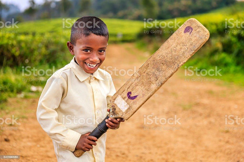 Sri Lankan little boy playing cricket on tea plantation stock photo