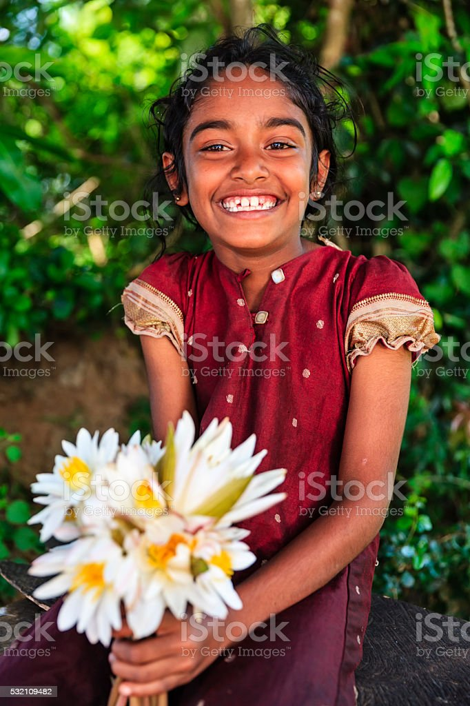 Sri Lankan little girl with lotus flowers stock photo