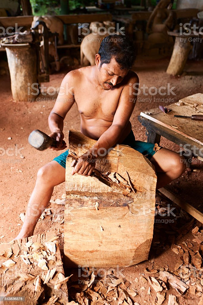 Sri Lankan man carving a wood sculpture. Kandy stock photo