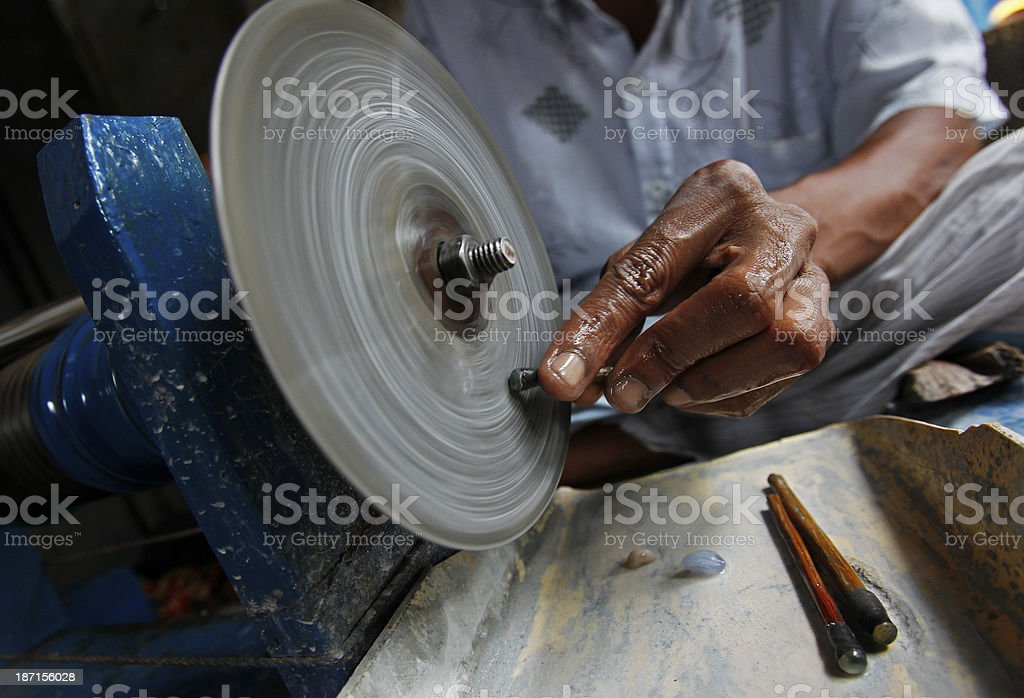 Sri Lankan miner cuts a gem stock photo