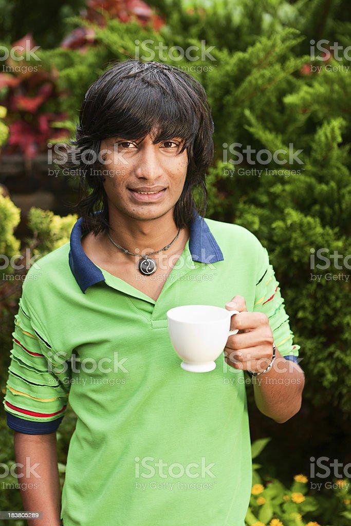 Sri Lankan teenager drinking tea royalty-free stock photo