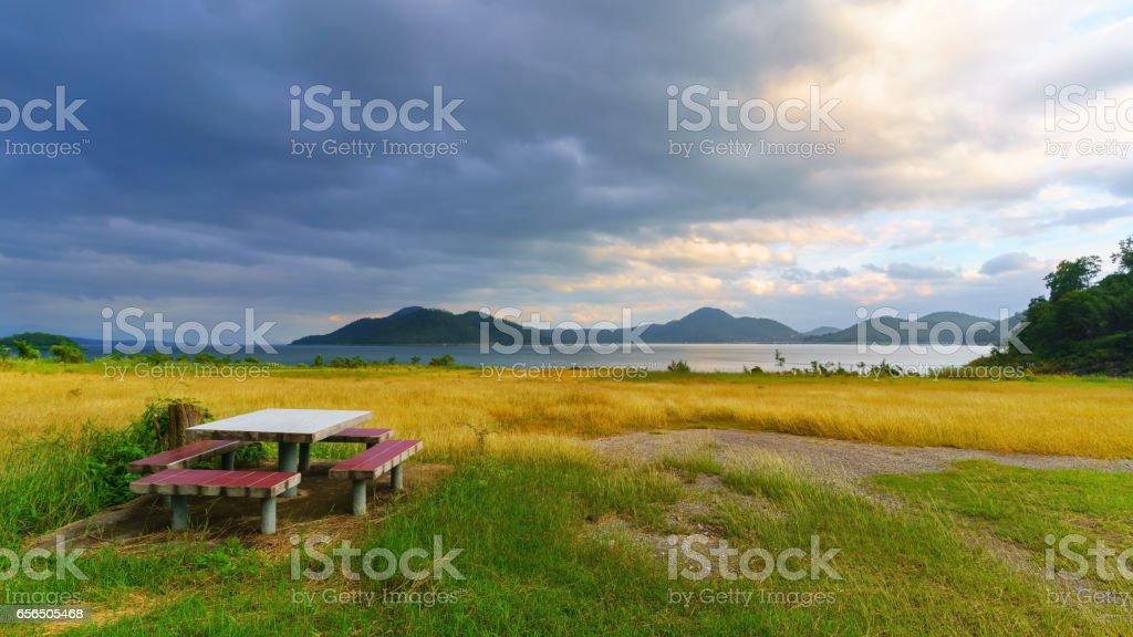 Srinagarind Reservoir or Srinakharin dam with golden meadow in the morning , Kanchanaburi Province , Thailand stock photo