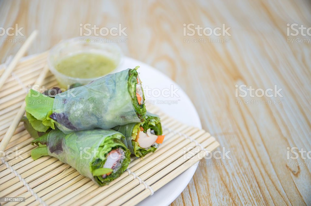 Srping rolls with crab stick and chicken sausage stock photo