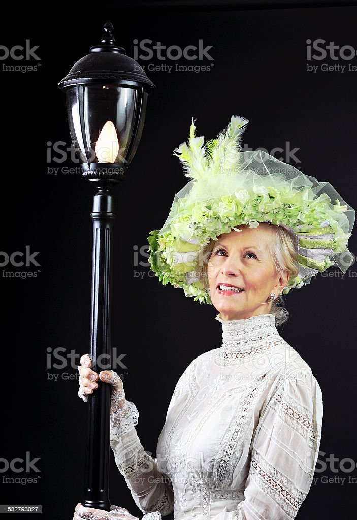 Ssenior Adult Female By Lamplight stock photo