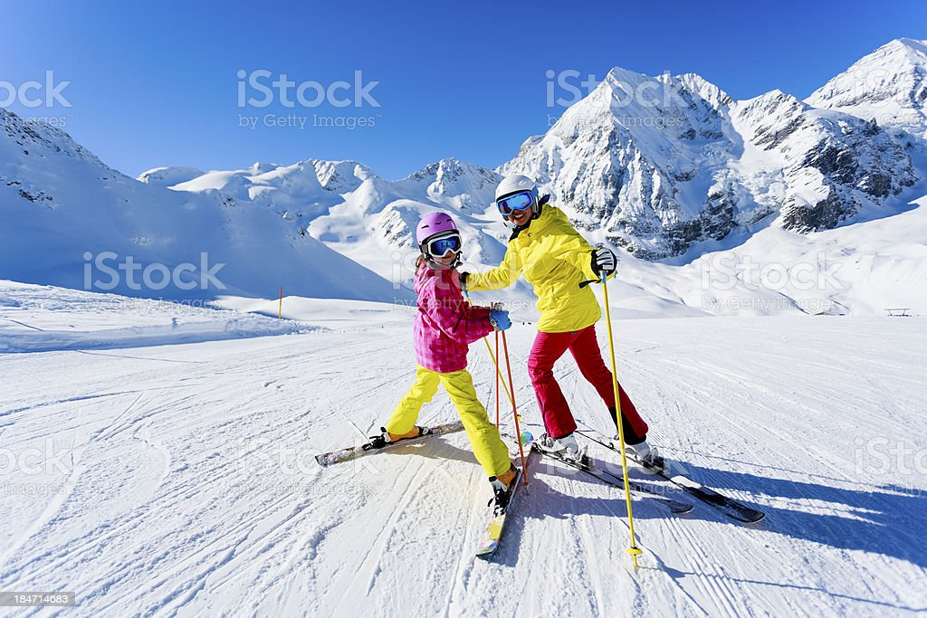 Sskiers on ski run stock photo