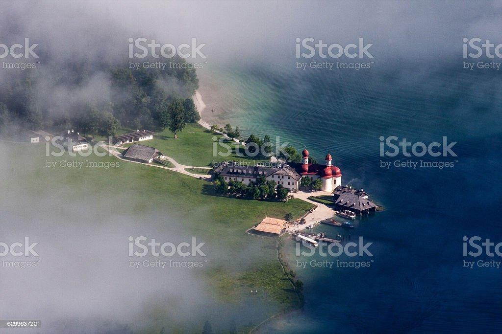 St. Bartholomä amidst the fog stock photo