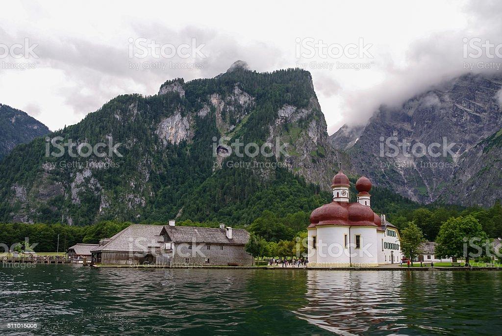 St. Bartholomae church at mountain lake Koenigssee, Bavaria, Ger stock photo