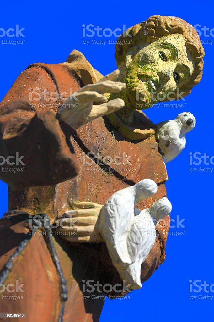 St. Francis of Assisi blessing us with doves stock photo