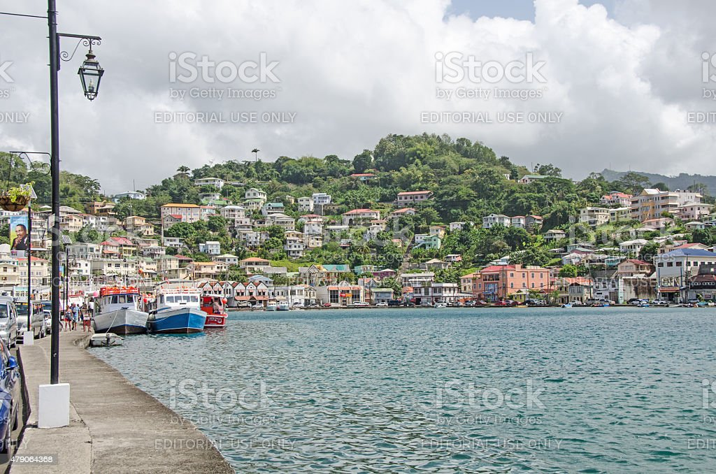 St. George's Grenada waterfront with fishing boats and boardwalk stock photo