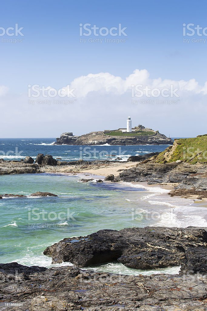 St Ives Bay, Cornwall with Lighthouse in Background. stock photo