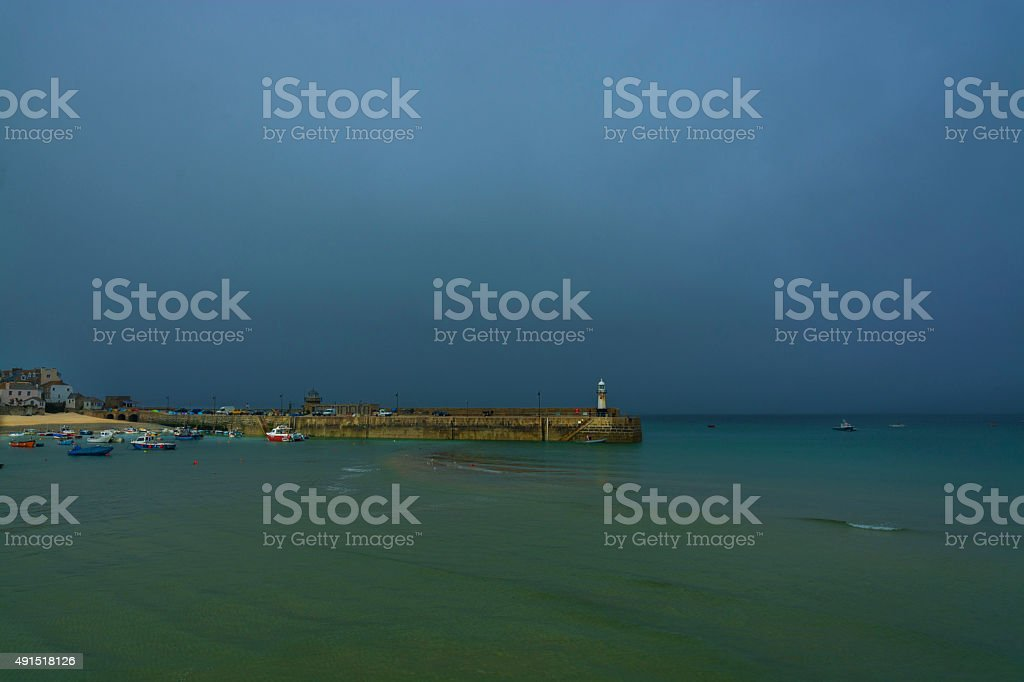 St Ives harbor boats and breakwater in mist and dusk stock photo