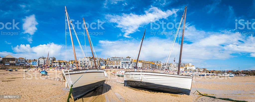 St Ives harbour Cornwall wooden fishing boats on summer beach stock photo
