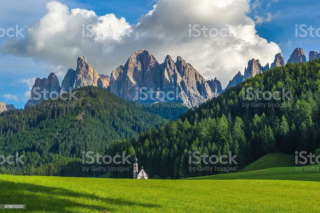 St. John church in front of the Odle mountains, Dolomites stock photo