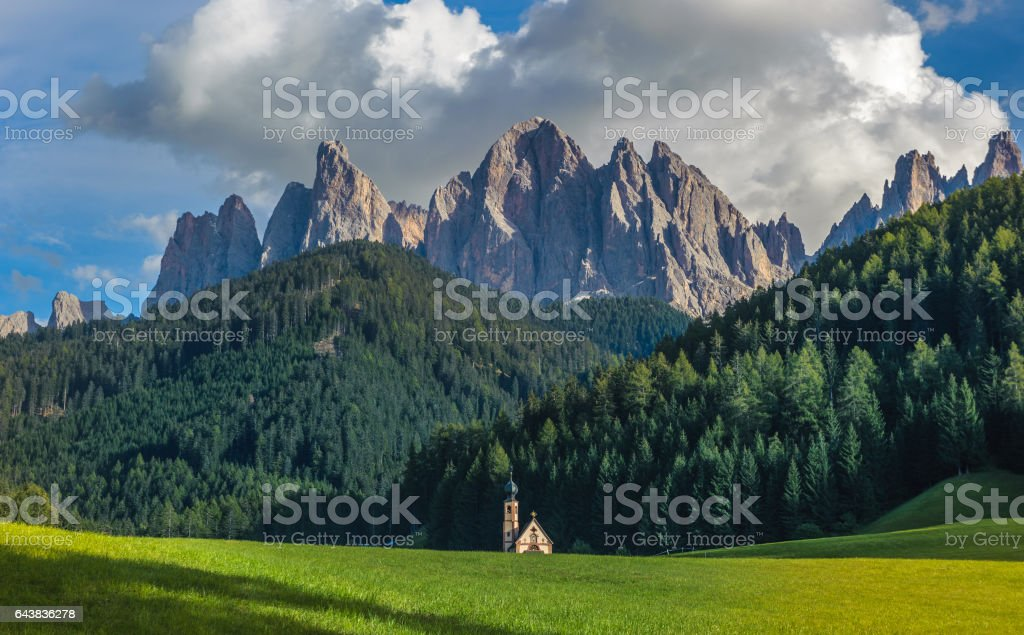 St. John church in front of the Odle mountains, Italy stock photo