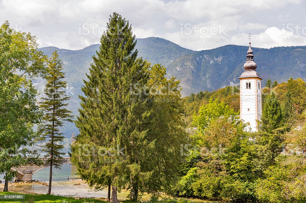 St John church on the Bohinj lake in Slovenia stock photo