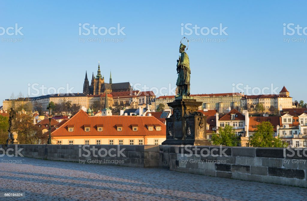 St. John Nepomuk and Prague Castle stock photo