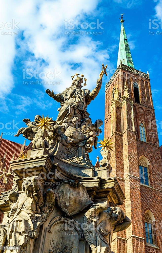 St. John of Nepomuk Column at Holy Cross church - stock photo