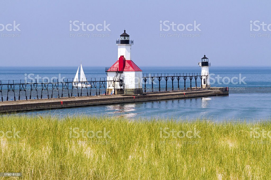 St. Joseph, Michigan Lighthouses and Sailboat stock photo