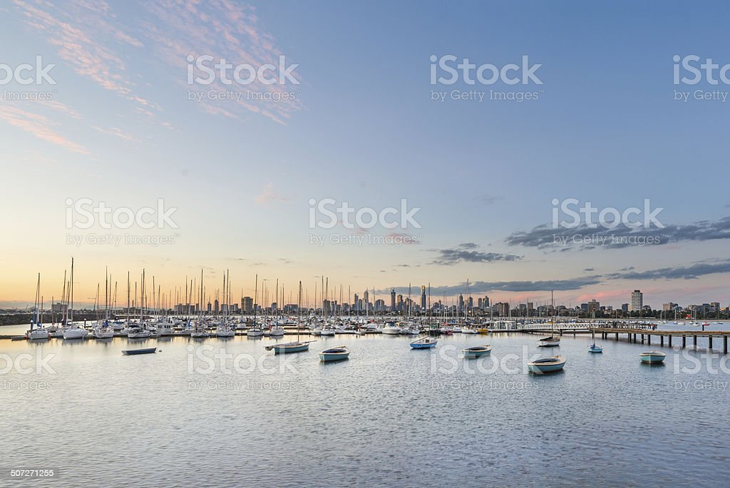 St Kilda harbour pier sunset with Melbourne city background stock photo