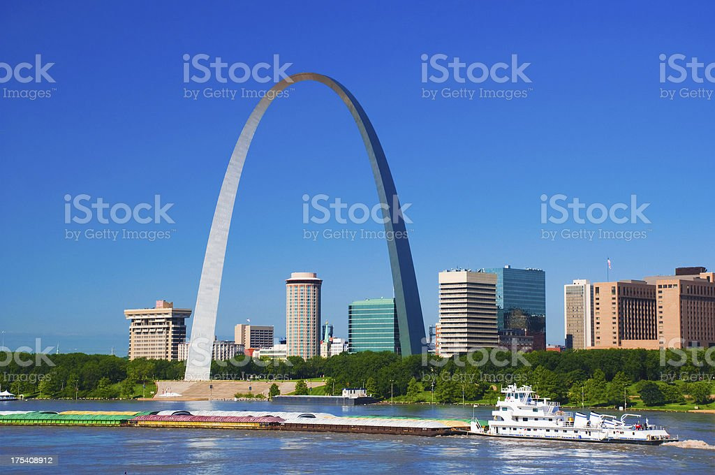 St. Louis skyline, arch, river, and boat stock photo