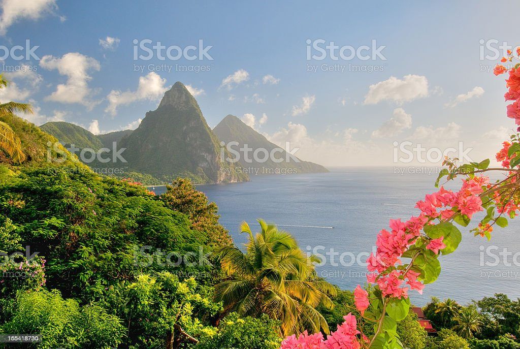 St. Lucia's Twin Pitons lit by sunset glow stock photo