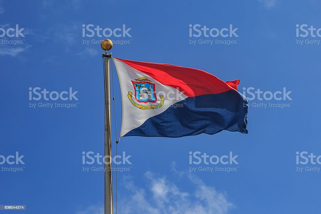St. Maarten flag in blue sky. stock photo