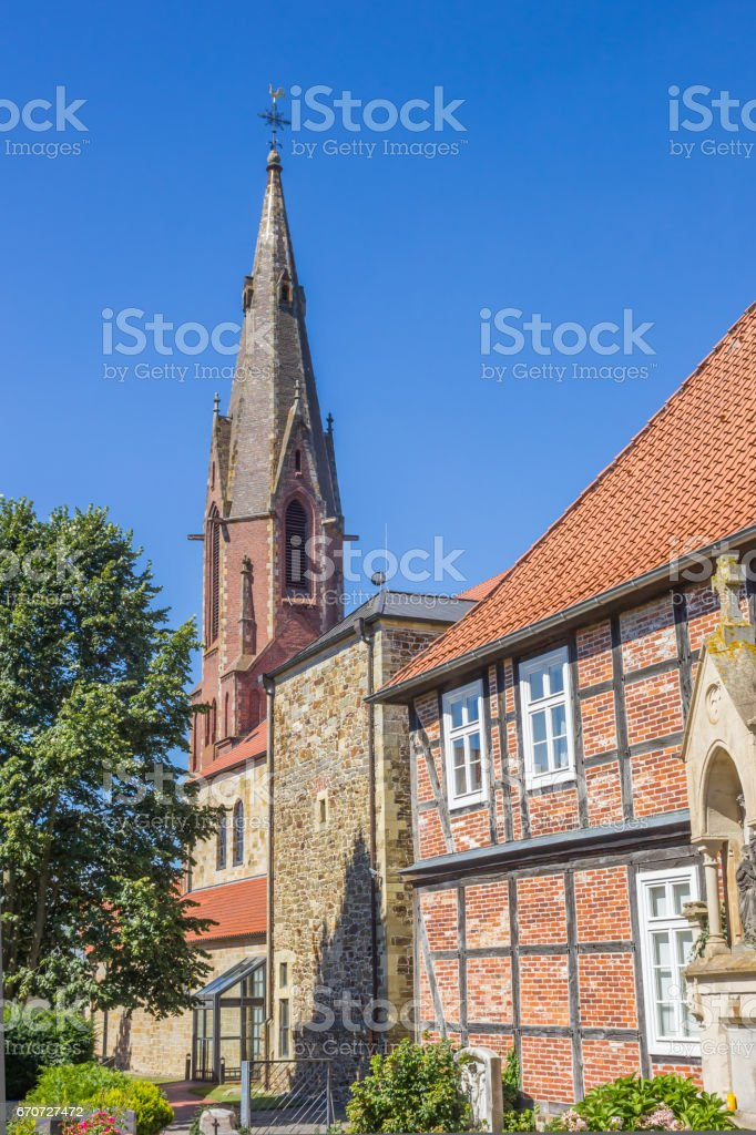 St. Marien church and old house in Quakenbruck, Germany stock photo