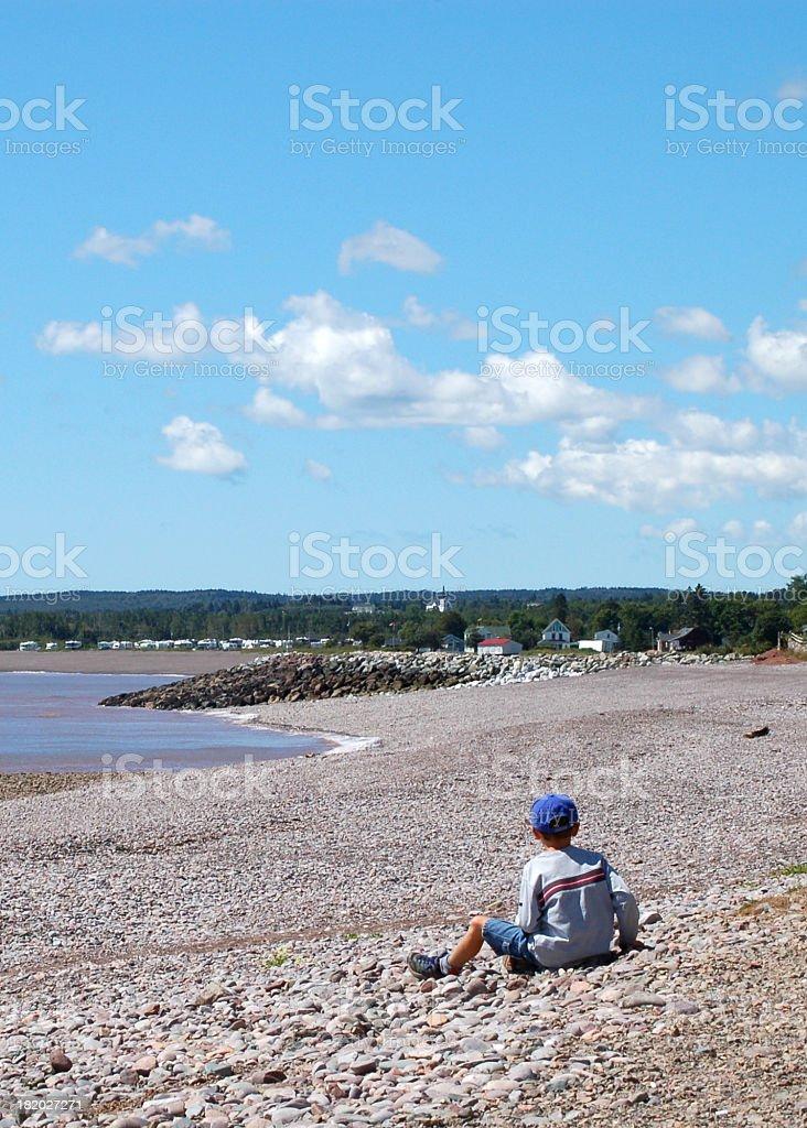 St. Martins Boy on Beach stock photo