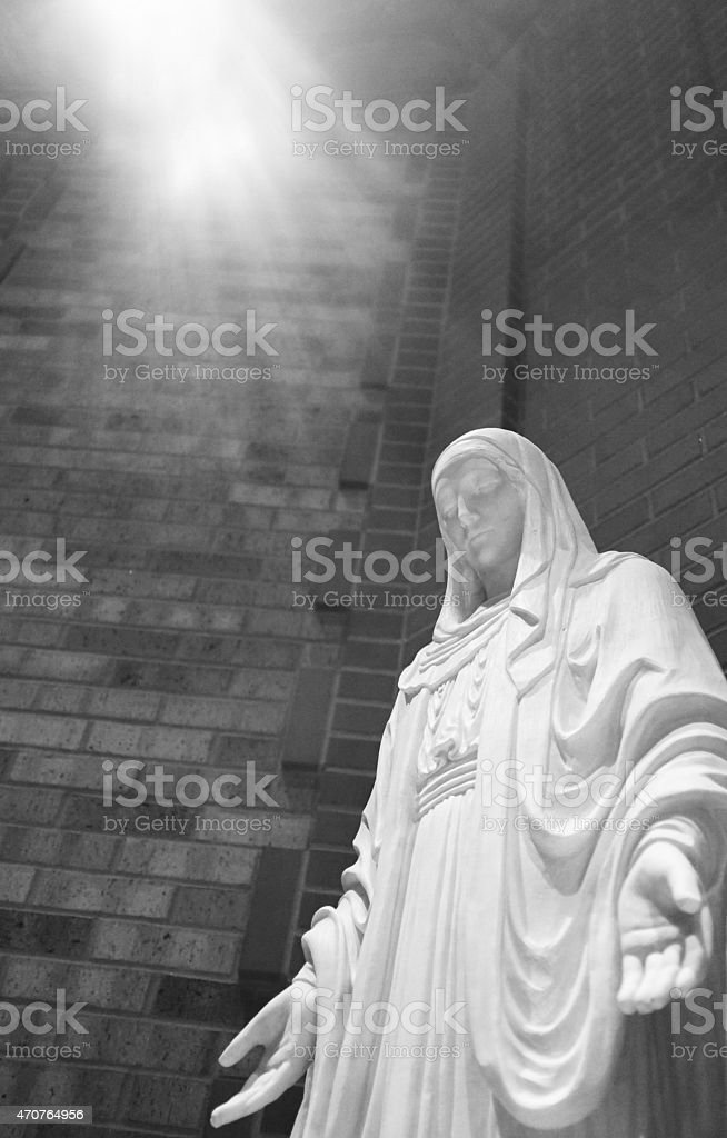 St. Mary Statue in shaft of light stock photo