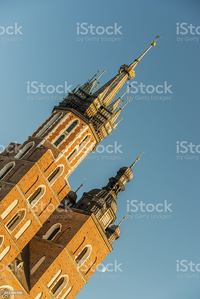 St Mary's church (Krakow) towers and the Moon stock photo