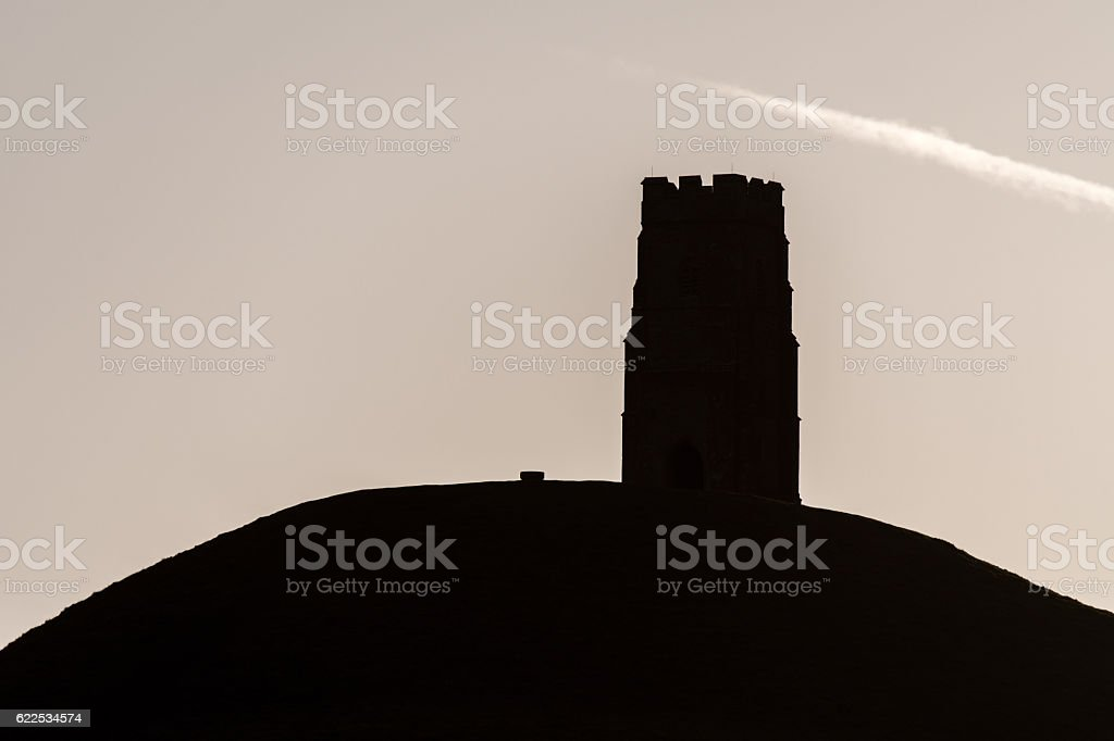 St. Michael's Tower silhouetted on Glastonbury Tor stock photo