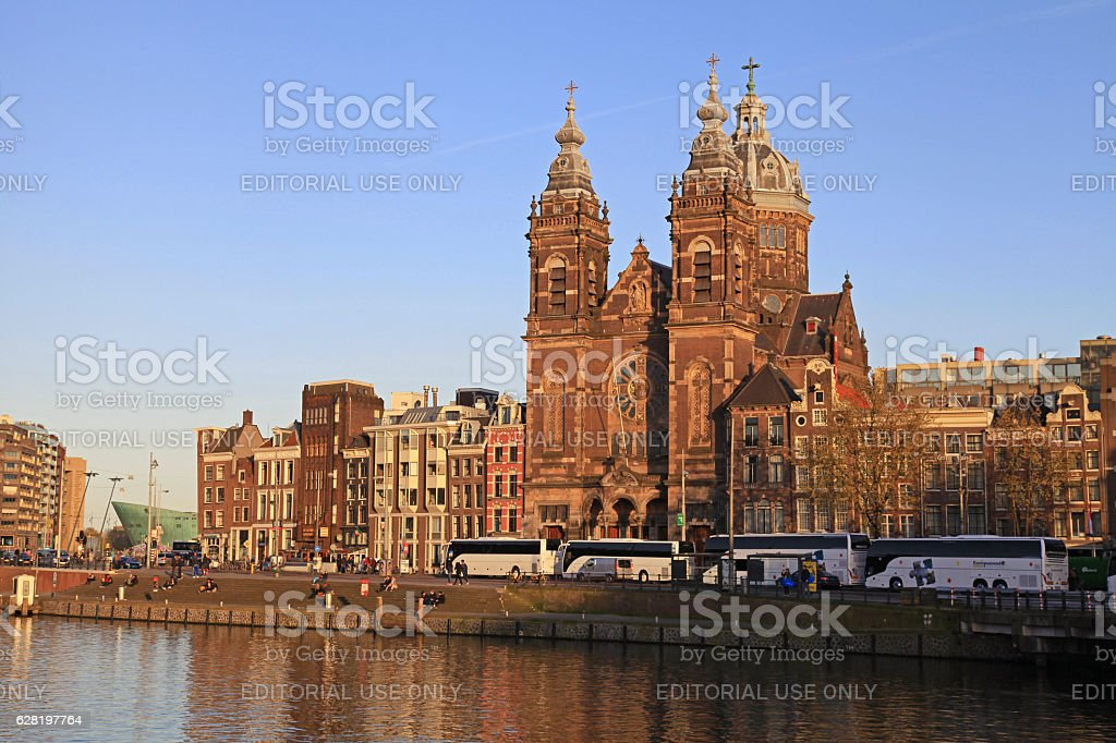 St Nicholas church and houses from across Amstel River, Amsterdam stock photo