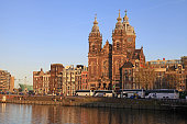 St Nicholas church and houses from across Amstel River, Amsterdam