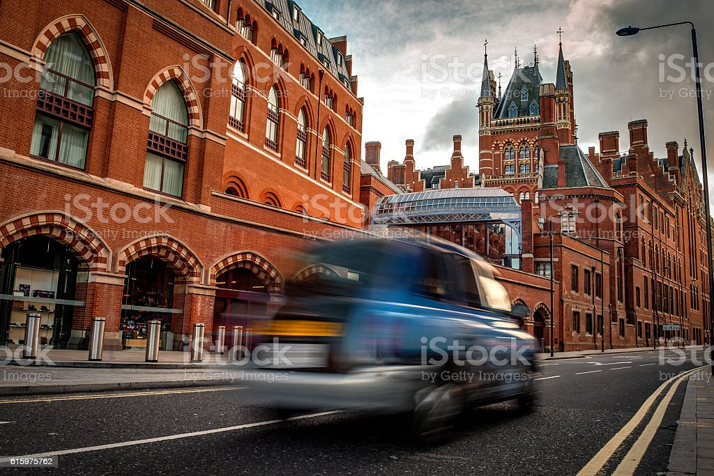 St Pancras international train station and a black cab taxi stock photo