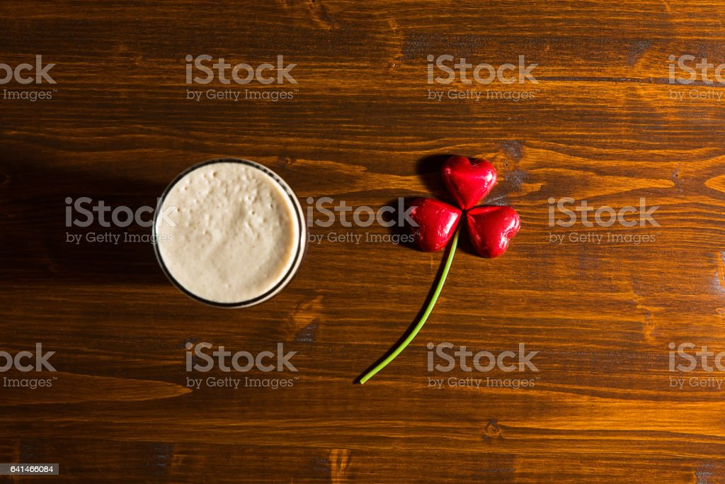 St Patrick day with a pint of black beer and shamrock stock photo