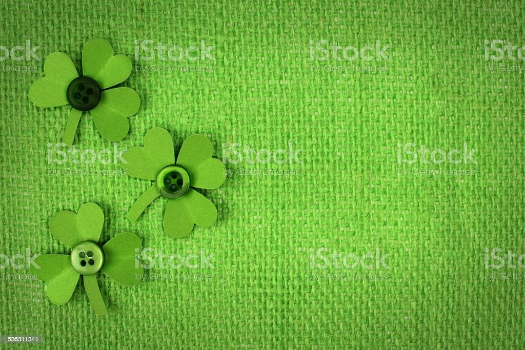 St Patricks Day burlap background with shamrocks stock photo