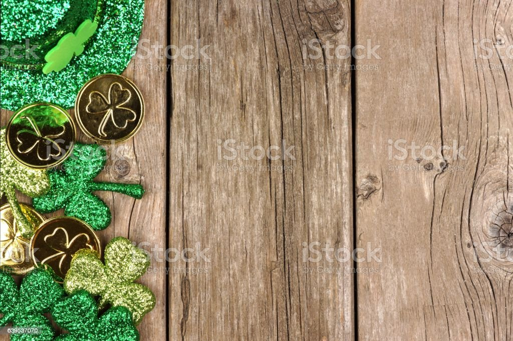 St Patricks Day decor side border over rustic wood stock photo