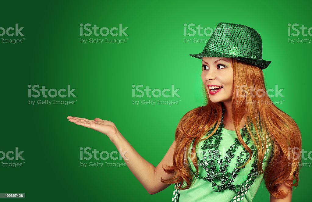 St Patricks day Girl. Cheerful young woman wearing green hat stock photo