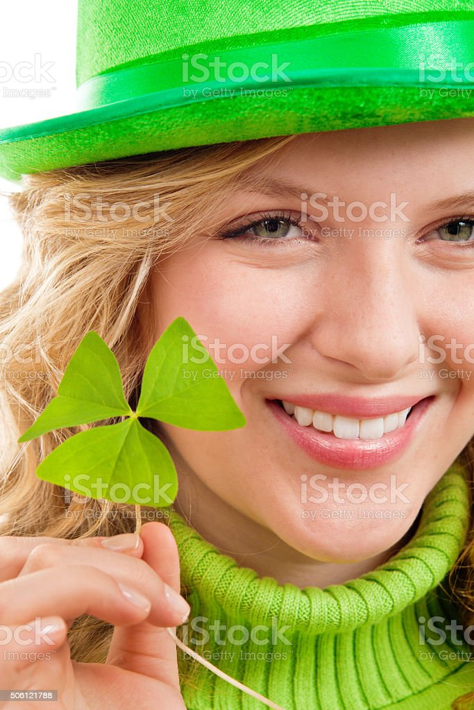 St. Patrick's Day Girl with with Green Clover Leaf on White stock photo