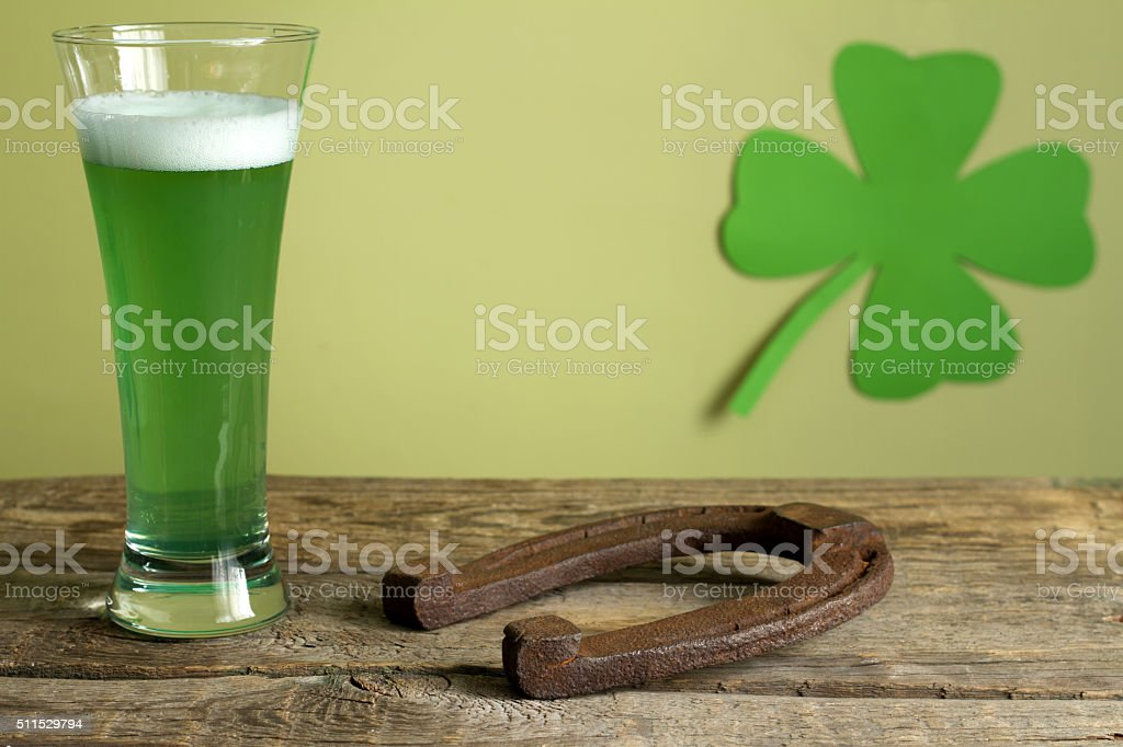 St. Patrick's Day green beer and horseshoe stock photo