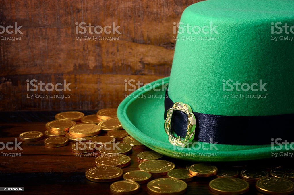 St Patricks Day hat and gold coins. stock photo