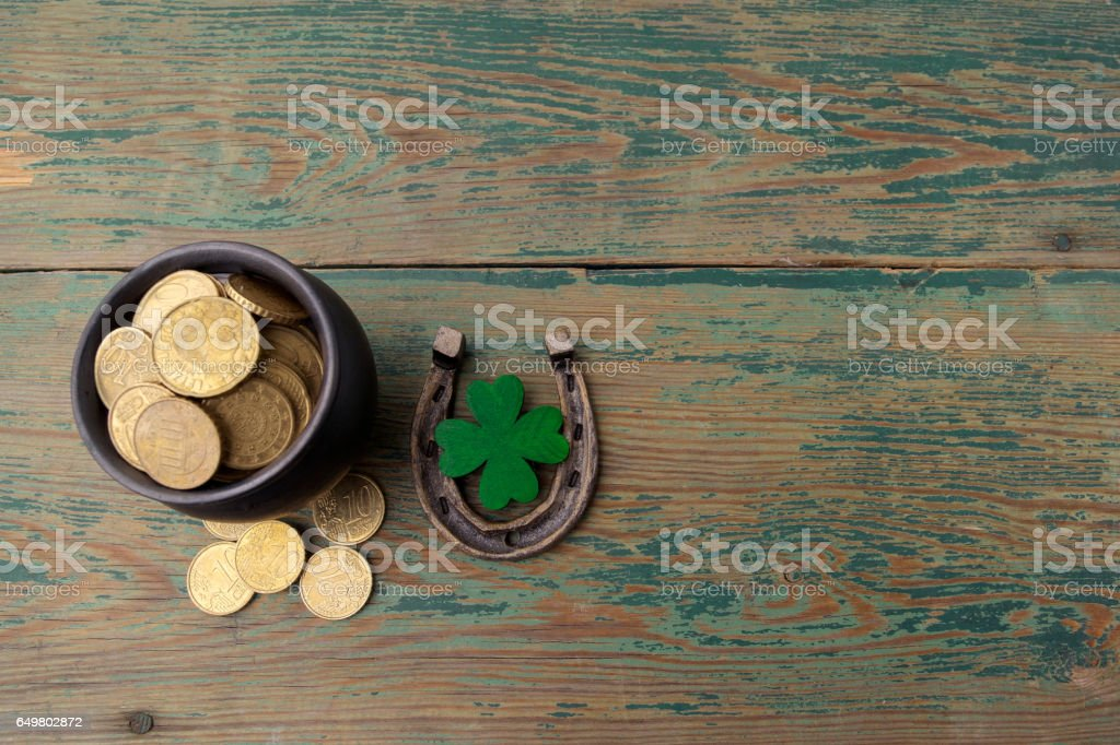 St. Patricks day, lucky charms. Horesechoe and shamrock on wooden background stock photo
