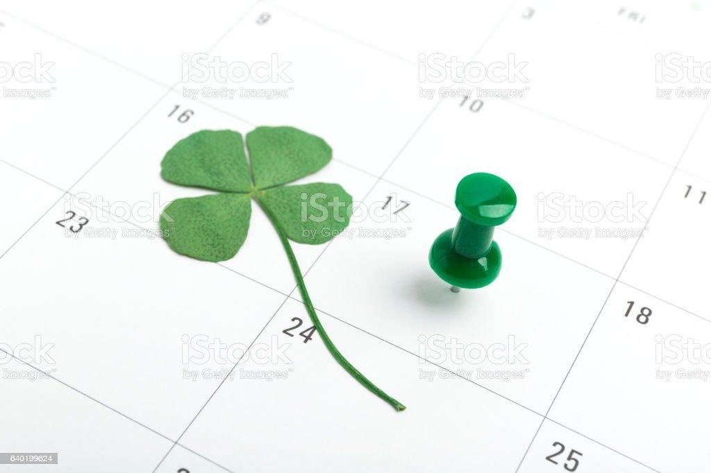 st patricks day on march calendar pin. stock photo