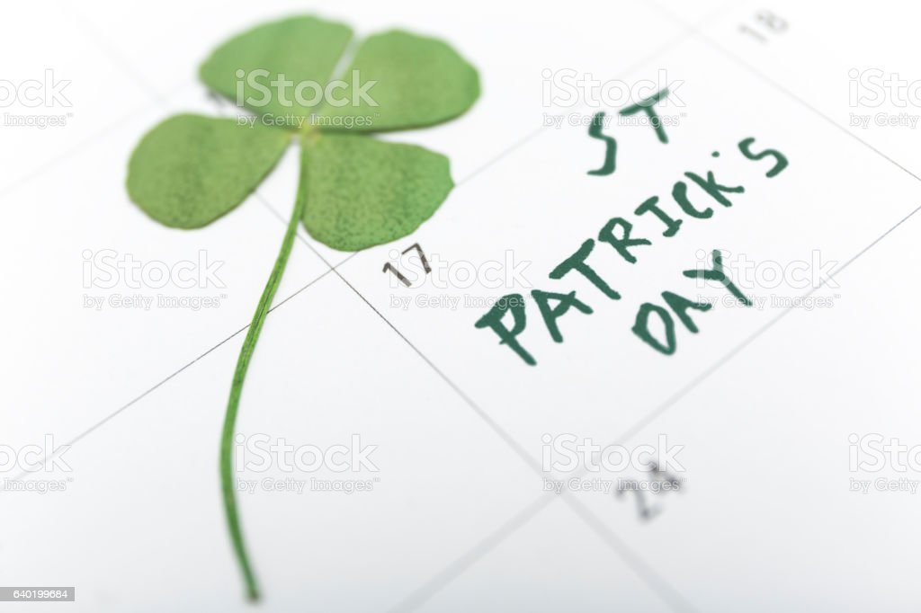 st patricks day on march calendar pin. stock photo