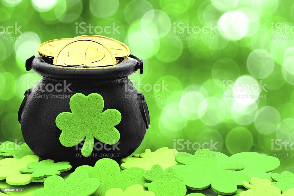St Patricks Day pot of gold on green background stock photo