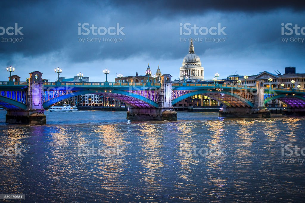 St Paul's Cathedral and amazing iluination of Southeark Bridge twilight stock photo