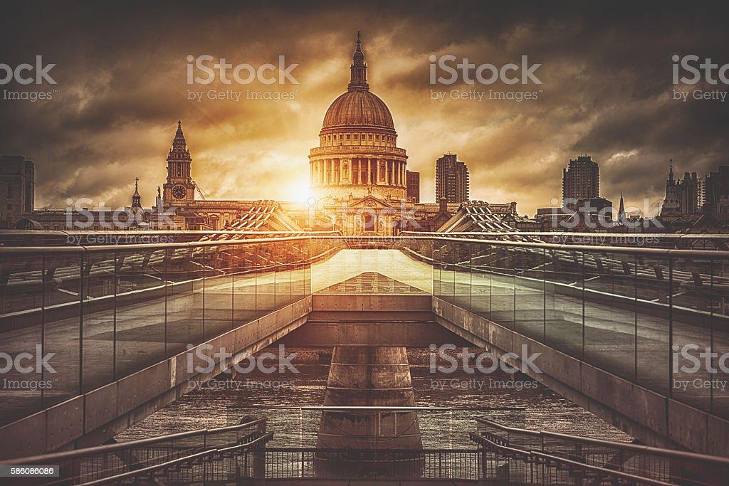 St. Paul's Cathedral and Millenium bridge at sunrise stock photo