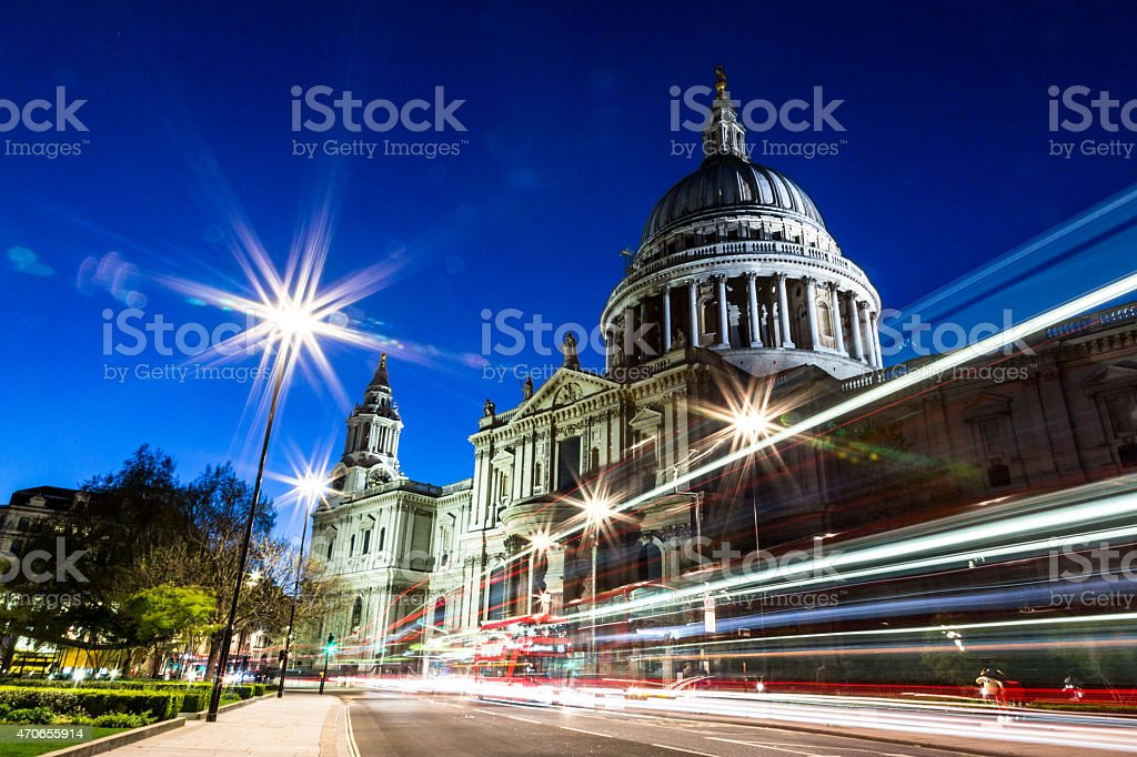 St Pauls Cathedral illuminated at night with traffic light trails stock photo