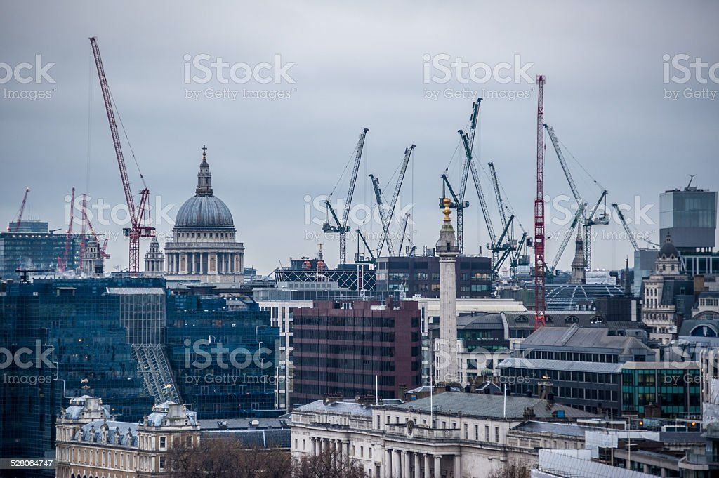 St Paul's Cathedral, Monument and construction cranes in London stock photo
