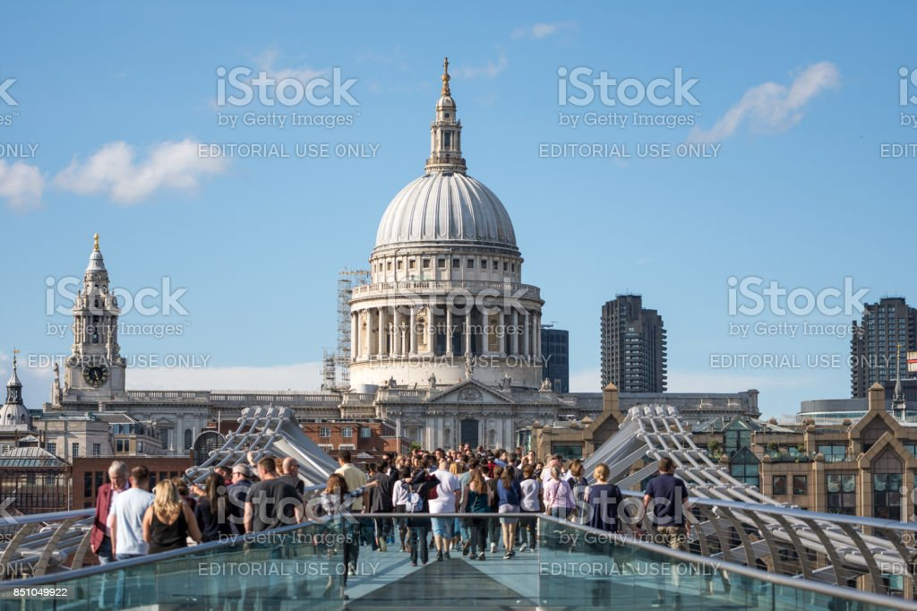 St Paul's Cathedral with people walking on the Millenium bridge in the foreground stock photo